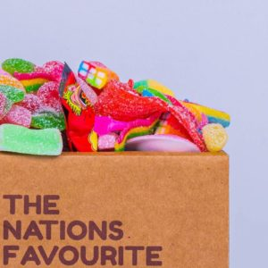 Closeup of full box of fizzy and sour sweets